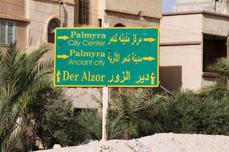 FILE PHOTO: A road sign is pictured in Palmyra city, Syria,  May 19, 2015. REUTERS/Stringer/File Photo