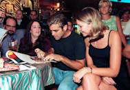 <p>Clooney visits with fans at Planet Hollywood in 1995 in Atlanta, Georgia.</p>