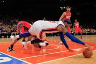 Carmelo Anthony (front) dives for a ball against the New Jersey Nets at Madison Square Garden on February 20, 2012 in New York . (Photo by Chris Trotman/Getty Images)