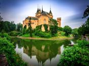 <p>This 12th-century castle boasts gothic architecture and, oh yeah, it also has a freakin' moat (!), so it's fit for a fairy tale.</p>
