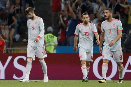 Soccer Football - World Cup - Group B - Portugal vs Spain - Fisht Stadium, Sochi, Russia - June 15, 2018 Spain's Gerard Pique, Jordi Alba and Koke look dejected after Portugal's Cristiano Ronaldo (not pictured) scored their second goal REUTERS/Carlos Barria