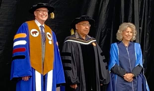 Miiksika'am, centre, as he's given his honorary doctor of laws Tuesday. University president Tim Rahilly said Wolfleg has become an icon at the institution and helped many Indigenous and non-Indigenous people with his wisdom.