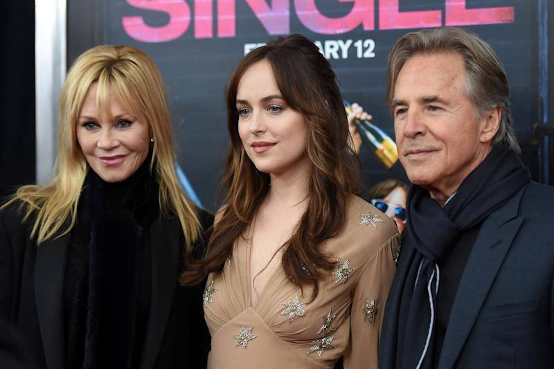 "Melanie Griffith, Dakota Johnson, and Don Johnson attend the New York premiere of ""How To Be Single"" on February 3, 2016. (Photo by Jamie McCarthy/Getty Images)"