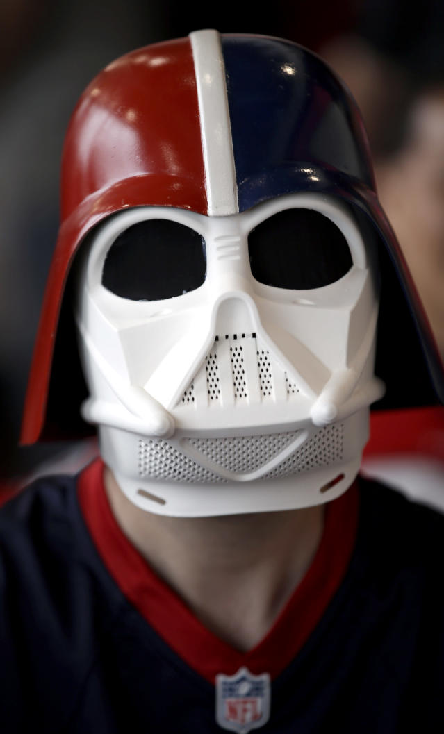 A Houston Texans fan who calls himself Darth Texan waits for the start of the NFL draft at a Houston Texans draft day party at NRG Stadium Thursday, May 8, 2014, in Houston. The Texans have the number one pick in the NFL draft. (AP Photo/David J. Phillip)