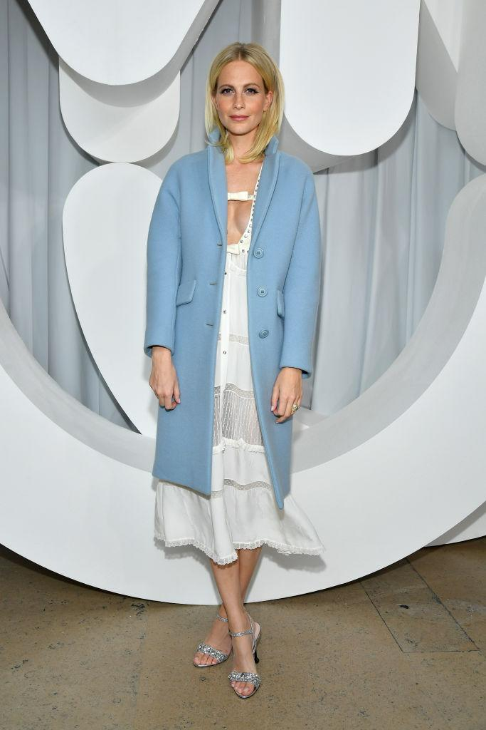 <p>Poppy Delevingne joined the FROW for the Miu Miu SS19 show in a powder blue coat and sheer midi dress. <em>[Photo: Getty]</em> </p>