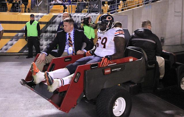 Chicago Bears defensive tackle Henry Melton (69) is taken off the field on a cart after being injured in the third quarter of an NFL football game against the Pittsburgh Steelers in Pittsburgh, Sunday, Sept. 22, 2013. (AP Photo/Gene J. Puskar)