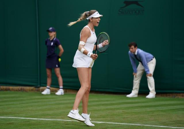 Katie Boulter leaps in celebration after defeating Danielle Lao