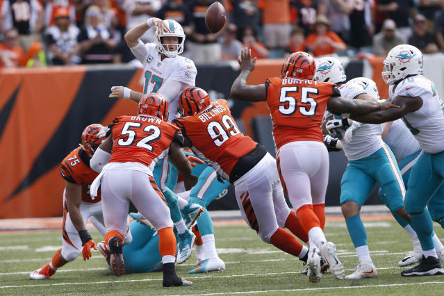 FILE - In this Oct. 7, 2018, file photo, Miami Dolphins quarterback Ryan Tannehill (17) throws an interception that was returned for a touchdown during the second half of an NFL football game against the Cincinnati Bengals, in Cincinnati. Last week the Miami Dolphins tried assigning eight players to help with pass protection, and even that didnt prevent Ryan Tannehill from getting hit. Hes getting hit too much, head coach Adam Gase said. Ive got to find a way to get the ball out of his hands, get guys open quicker, or figure something else out.(AP Photo/Gary Landers)
