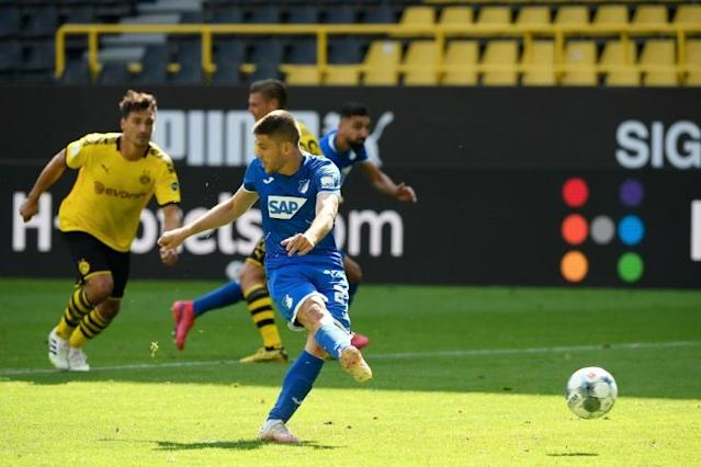 Hoffenheim forward Andrej Kramaric scores his fourth goal against Dortmund with a no-look penalty (AFP Photo/Ina FASSBENDER)