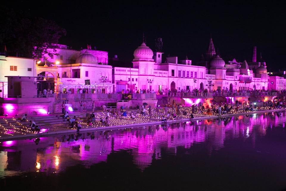 Devotees and local people of Ayodhya lit up earthen lamps on the banks of Saryu river on a day before the arrival of Prime Minister Narendra Modi for Gournd breaking ceremony of Ram Temple ,during the Covid 19 pandemic, in Ayodhya, India on August 4, 2020. (Photo by Ritesh Shukla/NurPhoto via Getty Images)
