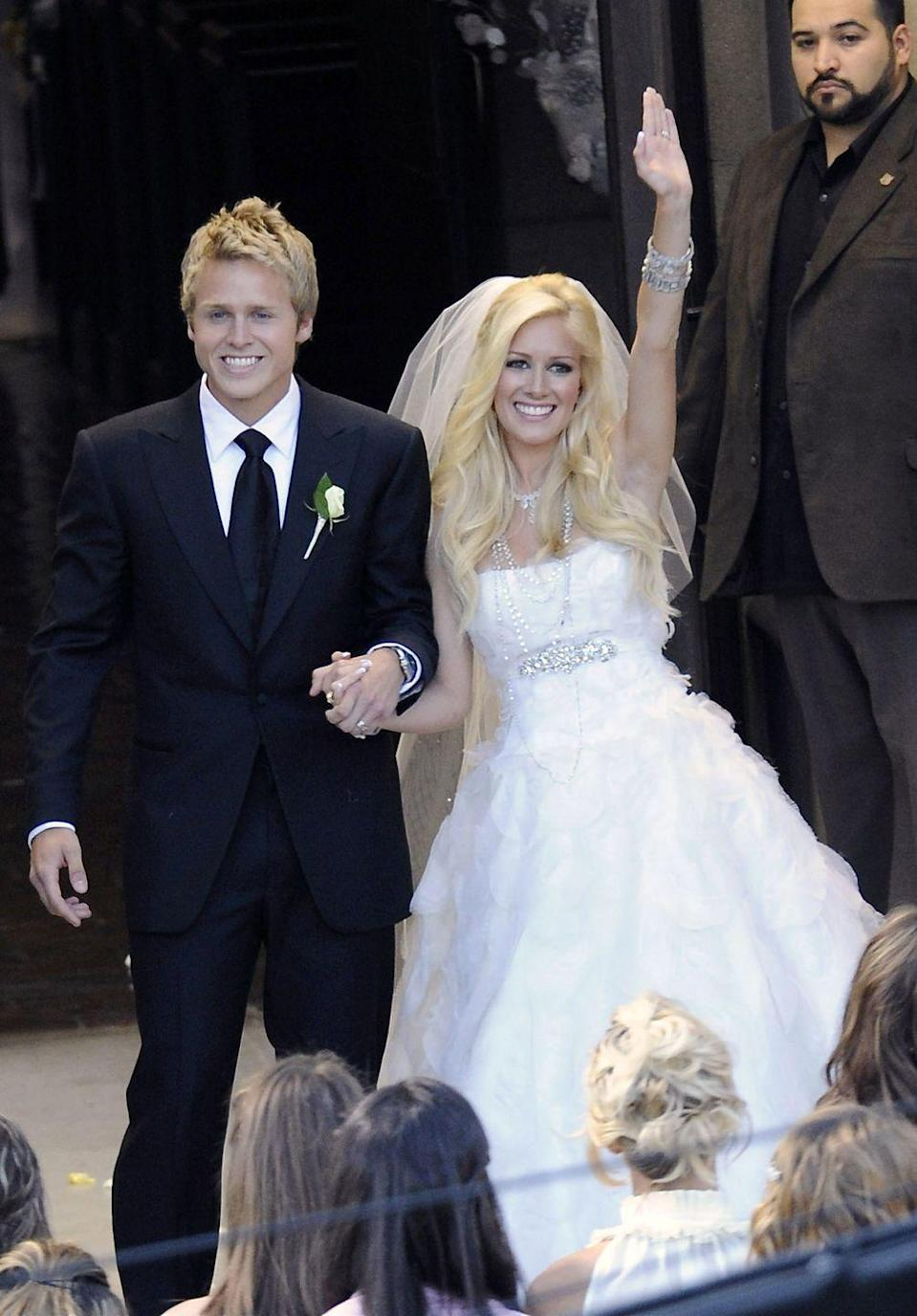 "<p>In a moment that would be viewed by millions on reality TV, Heidi Montag and Spencer Pratt exchanged their vows in front of a dramatic crowd on MTV's <em>The Hills</em>. Leading up to the moment, there were rumors that Heidi would design her own gown, but for the her big day she wore a <a href=""https://www.glamour.com/story/heidi-montags-wedding-dress-pa"" rel=""nofollow noopener"" target=""_blank"" data-ylk=""slk:Monique Lhuillier"" class=""link rapid-noclick-resp"">Monique Lhuillier</a> dress.</p>"