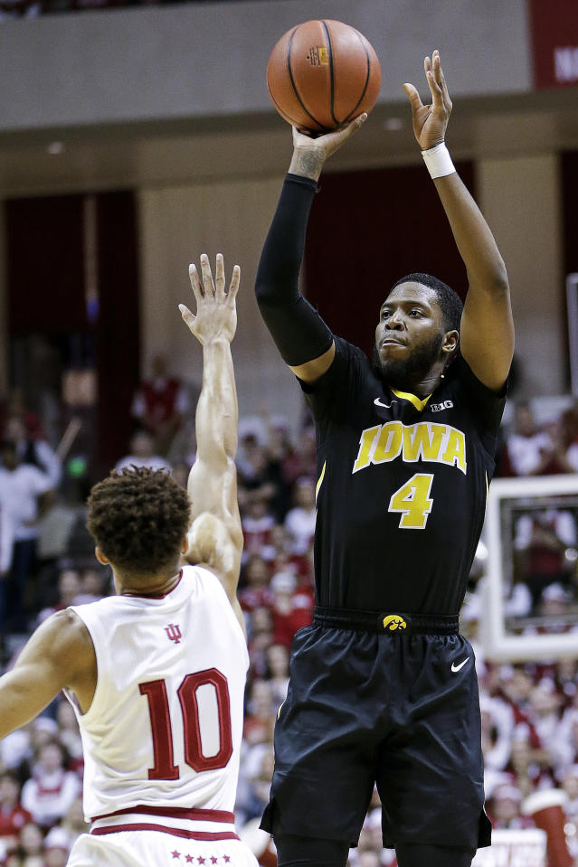 Iowa guard Isaiah Moss (4) shoots over Indiana guard Rob Phinisee (10) during the first half of an NCAA college basketball game in Bloomington, Ind., Thursday, Feb. 7, 2019. (AP Photo/AJ Mast)