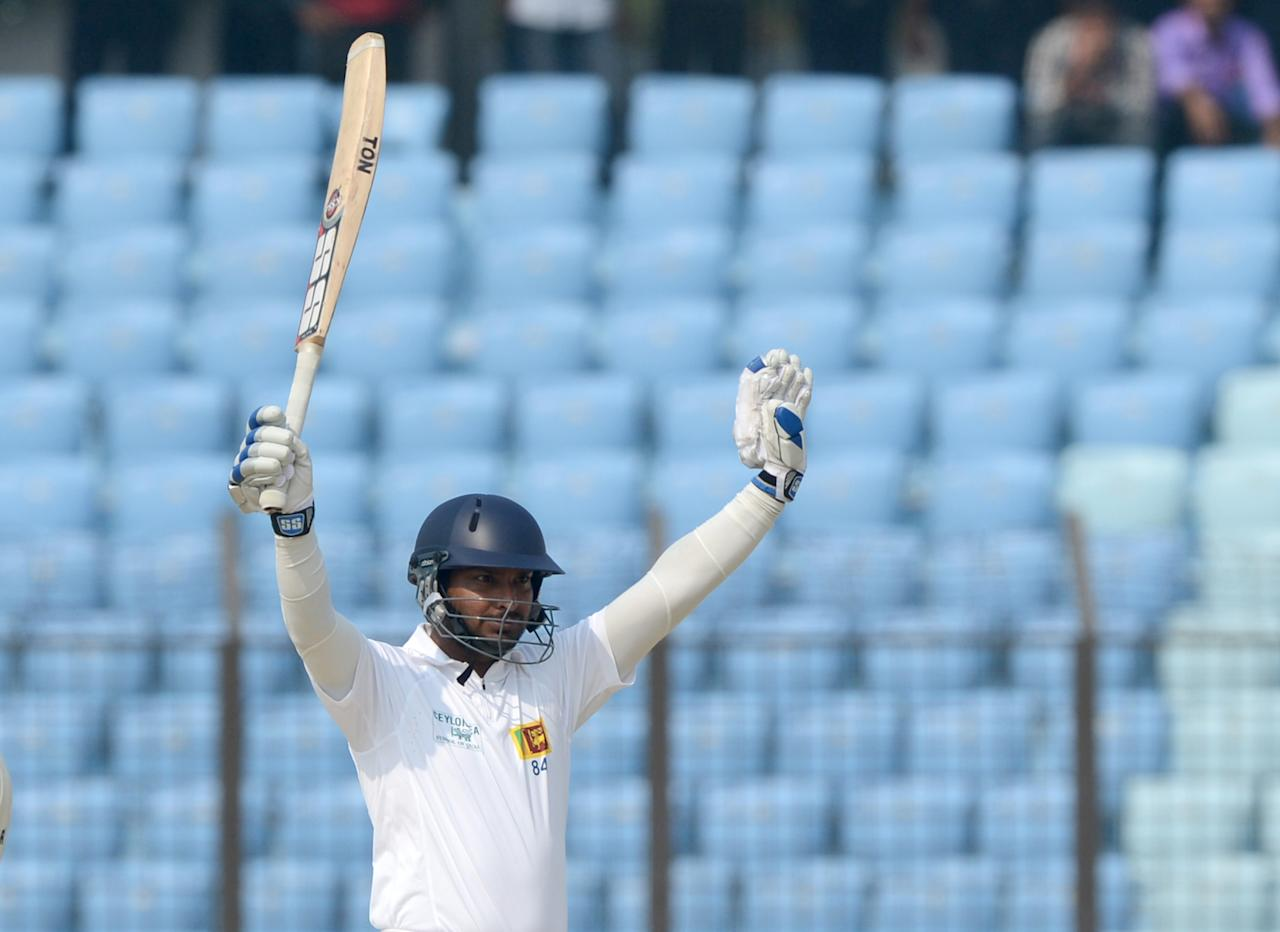 Sri Lankan batsman Kumar Sangakkara acknowledges the crowd after scoring a triple century (300 runs) during the second day of the second Test match between Bangladesh and Sri Lanka at The Zahur Ahmed Chowdhury Stadium in Chittagong on February 5, 2014. AFP PHOTO/ Munir uz ZAMAN
