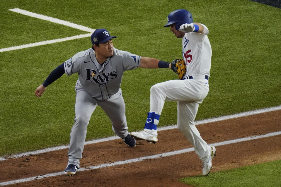 Tampa Bay Rays first baseman Ji-Man Choi tags out Los Angeles Dodgers' Austin Barnes during the third inning in Game 6 of the baseball World Series Tuesday, Oct. 27, 2020, in Arlington, Texas. (AP Photo/Sue Ogrocki)