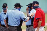 Boston Red Sox manager Ron Roenicke, right, talks with home plate umpire Marty Foster (60) before a baseball game against the Baltimore Orioles, Saturday, July 25, 2020, in Boston. (AP Photo/Michael Dwyer)