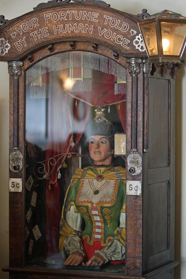 This July 28, 2011, photo shows an antique Gypsy fortune teller machine, that sat for decades in a Virginia City, Mont., restaurant and has received multimillion dollar offers from curators including magician David Copperfield. Collectors say the 100-year-old machine that speaks your fortune may be the last of its kind. (AP Photo/Michael Albans)