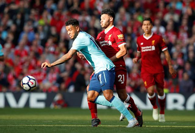 """Soccer Football - Premier League - Liverpool vs AFC Bournemouth - Anfield, Liverpool, Britain - April 14, 2018 Bournemouth's Joshua King in action with Liverpool's Alex Oxlade-Chamberlain REUTERS/Andrew Yates EDITORIAL USE ONLY. No use with unauthorized audio, video, data, fixture lists, club/league logos or """"live"""" services. Online in-match use limited to 75 images, no video emulation. No use in betting, games or single club/league/player publications. Please contact your account representative for further details."""