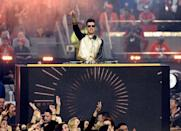 <p>Ronson wore a gold and black varsity jacket to DJ.</p>