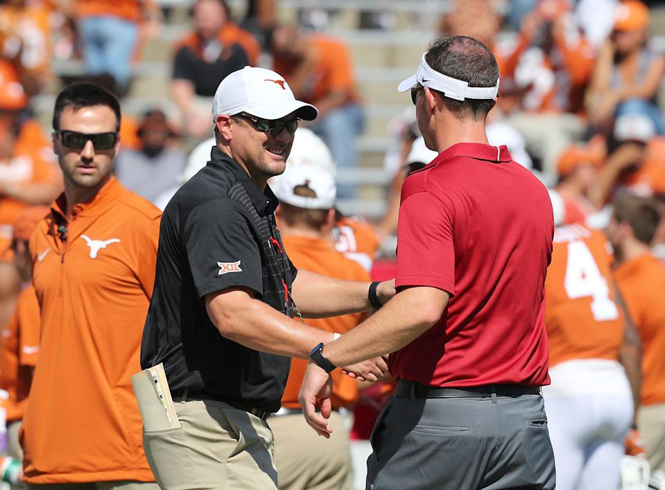 DALLAS, TX - OCTOBER 14:  Head coach Tom Herman of the Texas Longhorns  shakes hands with head coach Lincoln Riley of the Oklahoma Sooners before the football game at Cotton Bowl on October 14, 2017 in Dallas, Texas.  (Photo by Richard Rodriguez/Getty Images)