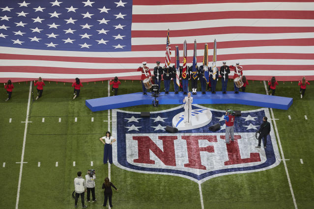 Singer Pink performs the national anthem during the pregame of the NFL Super Bowl 52 football game Sunday, Feb. 4, 2018, in Minneapolis. (AP Photo/Adam Bettcher)