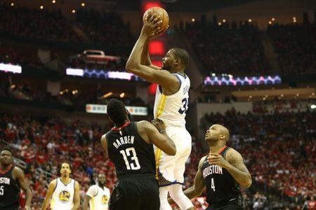 May 14, 2018; Houston, TX, USA; Golden State Warriors forward Kevin Durant (35) shoots over Houston Rockets guard James Harden (13) and forward PJ Tucker (4) during the fourth quarter in game one of the Western conference finals of the 2018 NBA Playoffs at Toyota Center. Mandatory Credit: Troy Taormina-USA TODAY Sports