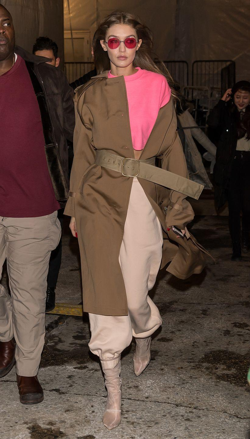 <p>Leaving the Jeremy Scott runway show in a pink Jeremy Scott sweatshirt and slouchy sweatpants with a Ports 1961 coat, nude mesh booties and Gentle Monster sunglasses.</p>