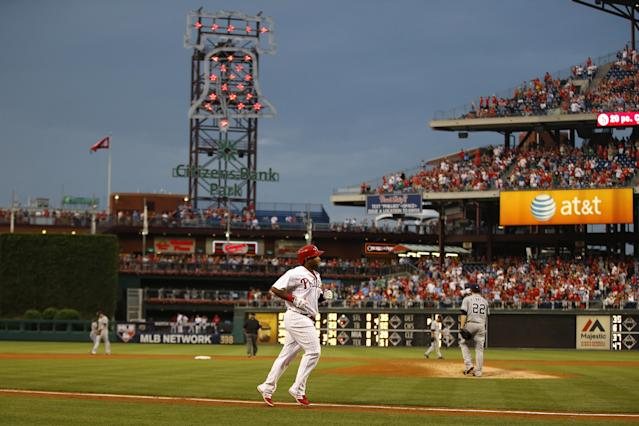 Philadelphia Phillies' Marlon Byrd, center, rounds the bases after hitting a three-run home run off San Diego Padres starting pitcher Ian Kennedy during the fourth inning of a baseball game, Tuesday, June 10, 2014, in Philadelphia. (AP Photo/Matt Slocum)