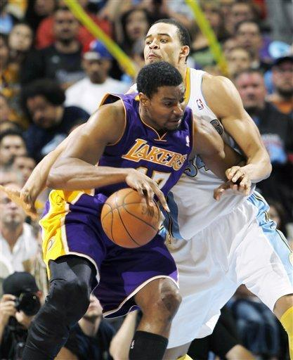 Los Angeles Lakers center Andrew Bynum, front, works the bal inside against Denver Nuggets center JaVale McGee in the fourth quarter of the Lakers' 92-88 victory in Game 4 of the teams' first-round NBA basketball series in Denver on Sunday, May 6, 2012. (AP Photo/David Zalubowski)