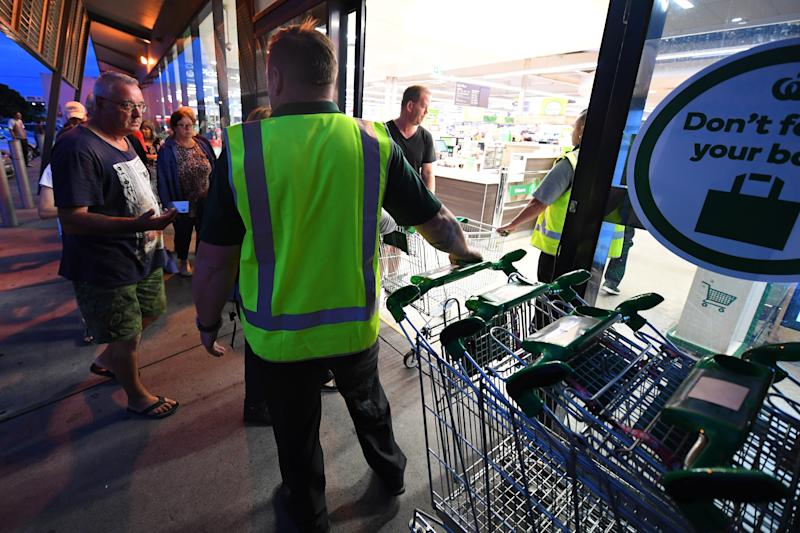 Shoppers enter a Woolworths supermarket in Melbourne. Source: AAP
