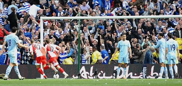 Queens Park Rangers' Scottish striker Jamie Mackie (3rd L) celebrates scoring their second goal during the English Premier League football match between Manchester City and Queens Park Rangers at The Etihad stadium in Manchester, north-west England on May 13, 2012. AFP PHOTO/PAUL ELLIS RESTRICTED TO EDITORIAL USE. No use with unauthorized audio, video, data, fixture lists, club/league logos or 'live' services. Online in-match use limited to 45 images, no video emulation. No use in betting, games or single club/league/player publications.PAUL ELLIS/AFP/GettyImages