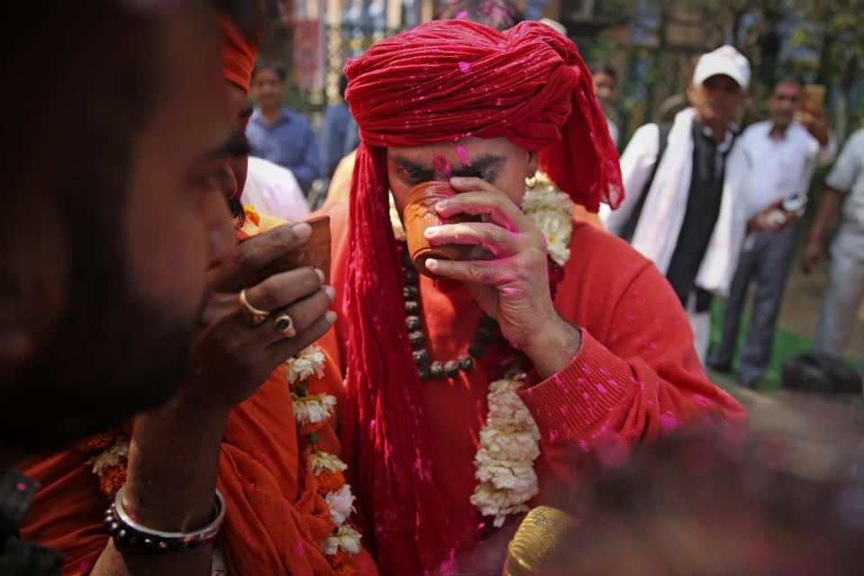 National president of Akhil Bhartiya Hindu Mahasabha Swami Chakrapani Maharaj drinks cow urine during an event organized by a Hindu religious group to promote consumption of cow urine as a cure for the new coronavirus in New Delhi, India, Saturday, March 14, 2020. The vast majority of people recover from the new coronavirus. According to the World Health Organization, people with mild illness recover in about two weeks, while those with more severe illness may take three to six weeks to recover. (AP Photo/Altaf Qadri)