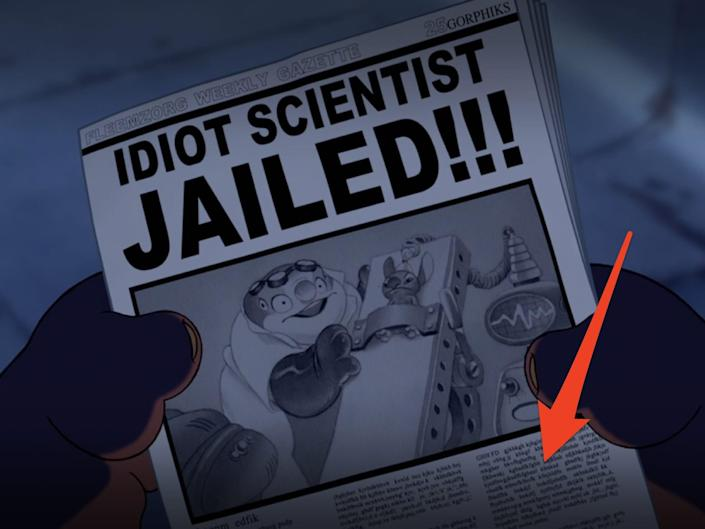 arrow pointing at newspaper in lilo and stitch scene