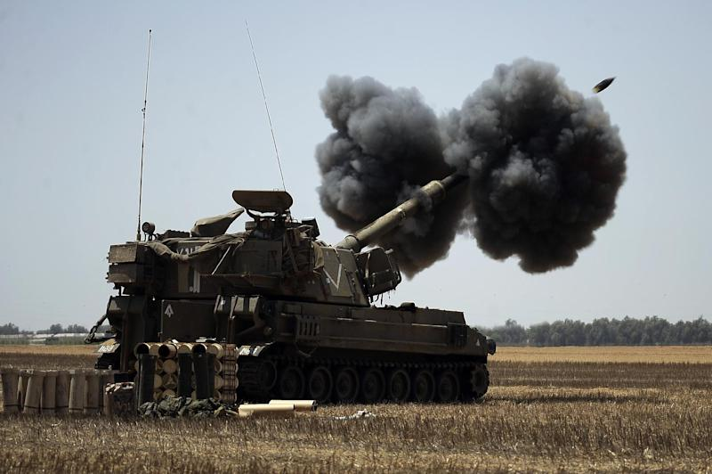 An Israeli artillery fires a 155mm shell towards targets in the Gaza Strip from their position near Israel's border with the Palestinian enclave on August 2, 2014