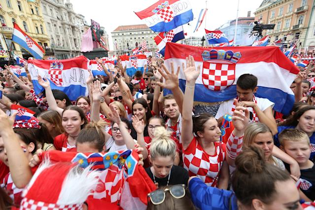 Soccer Football - World Cup - The Croatia team return from the World Cup in Russia - Zagreb, Croatia - July 16, 2018 Croatia fans await the arrival of the team at the main square in Zagreb REUTERS/Antonio Bronic