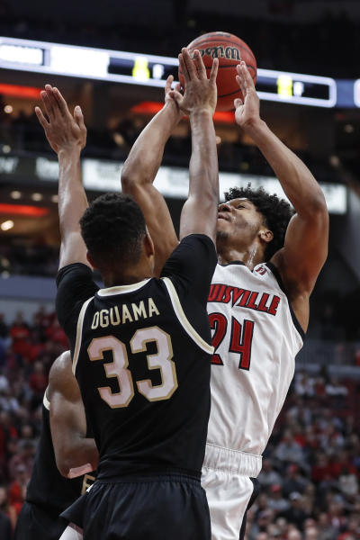 Louisville forward Dwayne Sutton (24) is fouled by Wake Forest forward Ody Oguama (33) during the second half of an NCAA college basketball game Wednesday, Feb. 5, 2020, in Louisville, Ky. Louisville won 86-76. (AP Photo/Wade Payne)