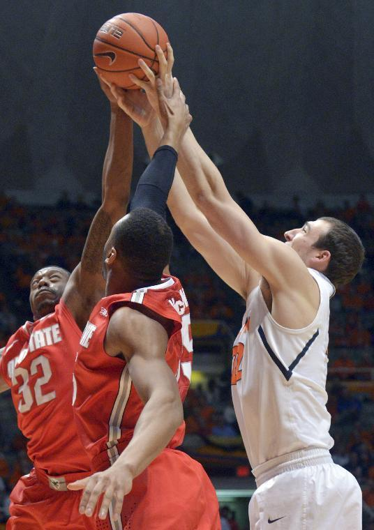 Illinois' Maverick Morgan, right, tries to get an offensive rebound along with Ohio State's guard Lenzelle Smith Jr. (32) and Ohio State's center Trey McDonald during the first half of an NCAA college basketball game in Champaign, Ill., on Saturday, Feb. 15, 2014. (AP Photo/Robin Scholz)