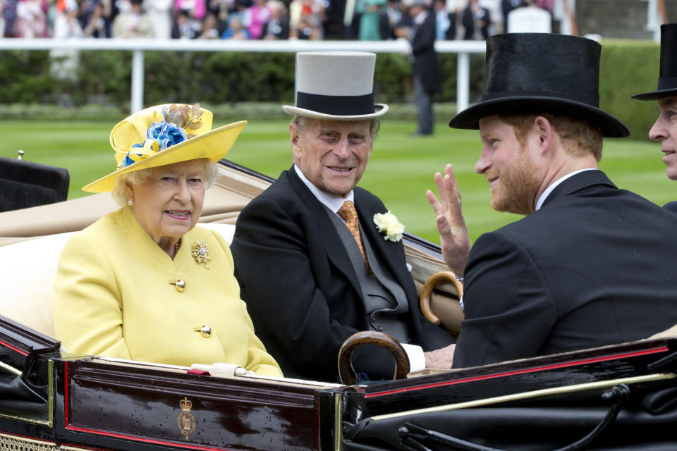 ASCOT, ENGLAND - JUNE 14:  Queen Elizabeth II, and Prince Philip, the Duke of Edinburgh, with Prince Harry, attend the first day of The Royal Ascot race meeting on June 14, 2016 in Ascot, England.(Photo by Julian Parker/UK Press via Getty Images)
