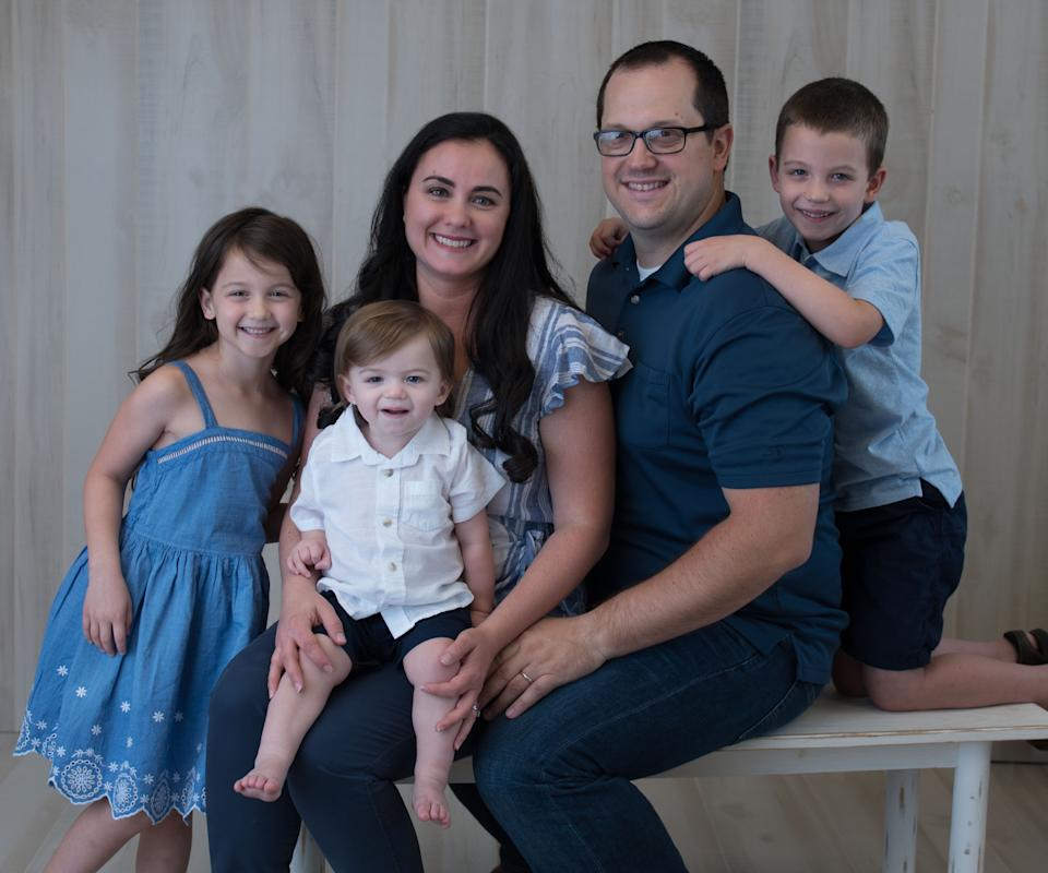 Marisa Davidson poses with her husband and three children