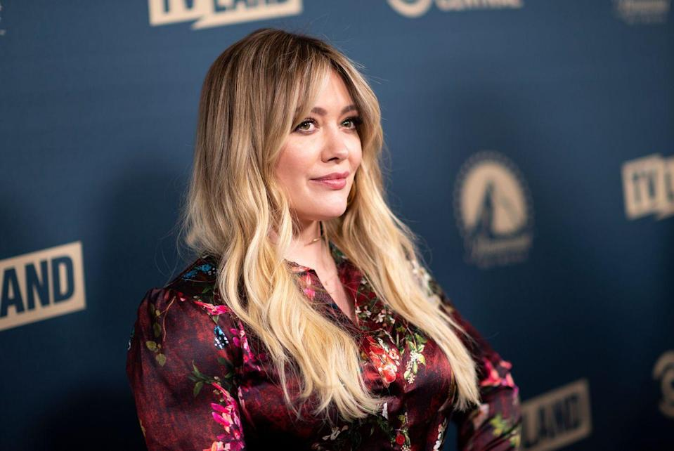 """<p>Before Hilary Duff recently debuted her <a href=""""https://www.goodhousekeeping.com/life/entertainment/a29849227/hilary-duff-lizzie-mcguire-bangs-photos/"""" rel=""""nofollow noopener"""" target=""""_blank"""" data-ylk=""""slk:new bangs for the Lizzie McGuire reboot"""" class=""""link rapid-noclick-resp"""">new bangs for the Lizzie McGuire reboot</a>, she rocked a set of long, center-parted bangs swept to both sides — an easy look for a cool '70s vibe.</p>"""