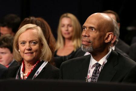 Meg Whitman (L), the president and chief executive of Hewlett Packard Enterprise, and basketball hall of famer Kareem Abdul-Jabbar sit together before the third and final 2016 presidential campaign debate between Republican U.S. presidential nominee Donald Trump and Democratic U.S. presidential nominee Hillary Clinton at UNLV in Las Vegas, Nevada, U.S., October 19, 2016.  REUTERS/Lucy Nicholson