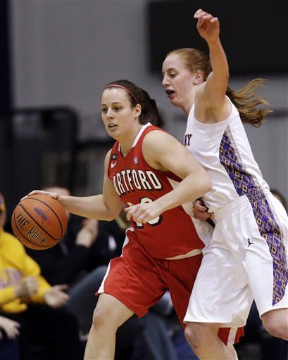 Hartford guard Alyssa Englert, left, moves the ball against Albany forward Julie Forster (11) during the first half of their NCAA college basketball game in the championship of the America East Conference tournament, Saturday, March 16, 2013, in Albany, N.Y. (AP Photo/Mike Groll)