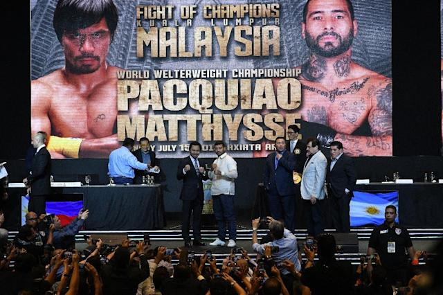 Manny Pacquiao (centre L) will fight Lucas Matthysse (centre R) for the WBA welterweight title in July (AFP Photo/TED ALJIBE)