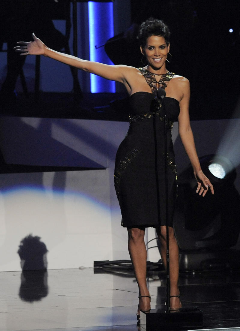 """Actress Halle Berry introduces singer Jennifer Hudson onstage at """"We Will Always Love You: a Grammy Salute to Whitney Houston,"""" at Nokia Theatre on Thursday, Oct. 11, 2012, in Los Angeles. The one-hour concert tribute will air on CBS on Nov. 16. (Photo by Chris Pizzello/Invision/AP)"""