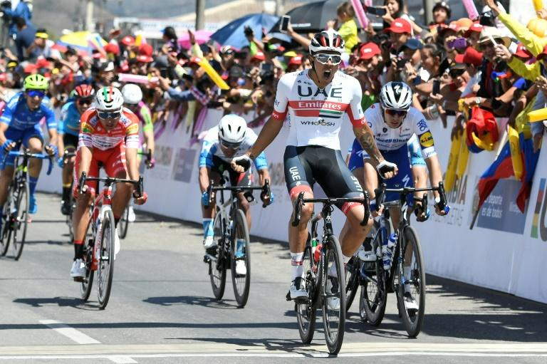 Colombian Juan Sebastian Molano (in white) of UAE Team Emirates celebrates winning the second stage of the Tour Colombia