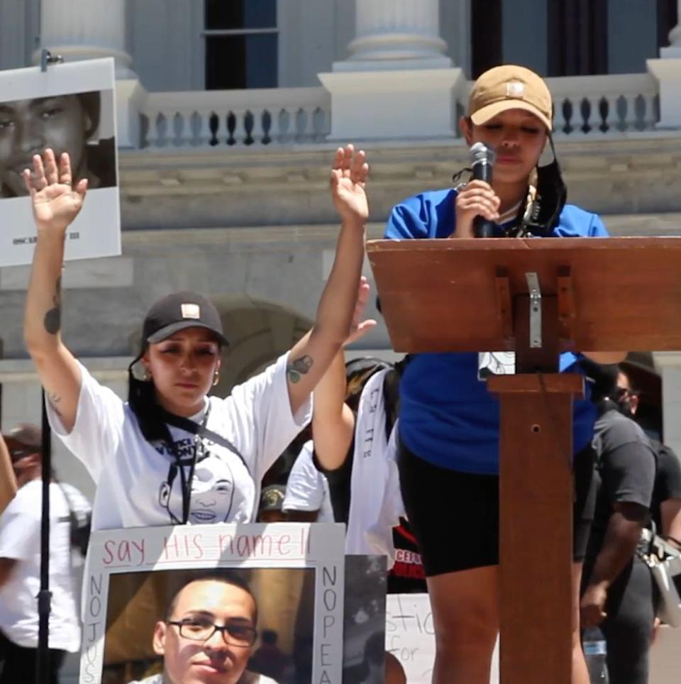 Sean Monterrosa's sisters Michelle (left) and Ashley (right) at a rally for victims of police violence in Sacramento, California, on July 1. (Photo: Monterrosa)