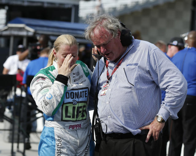 Pippa Mann, of England, talks with Dale Coyne after she failed to make the field for the IndyCar Indianapolis 500 auto race at Indianapolis Motor Speedway in Indianapolis, Saturday, May 19, 2018. (AP Photo/Rob Baker)