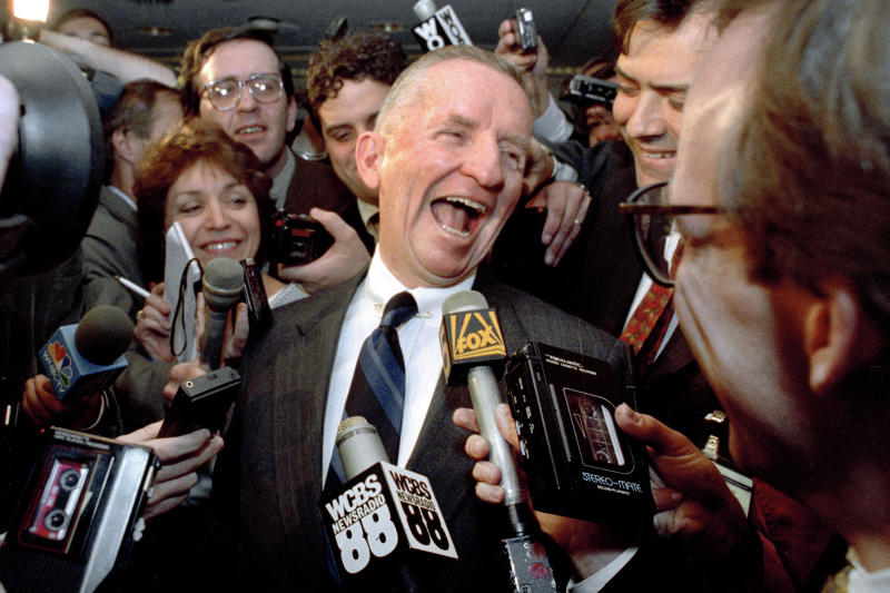 "FILE - This May 5, 1992 file photo shows Texas billionaire Ross Perot laughing after saying ""Watch my lips,"" in response to reporters asking when he plans to formally enter the presidential race. Perot, the colorful, self-made Texas billionaire who rose from a childhood of Depression-era poverty and twice ran for president as a third-party candidate, has died. He was 89. (AP Photo/Richard Drew. File)"