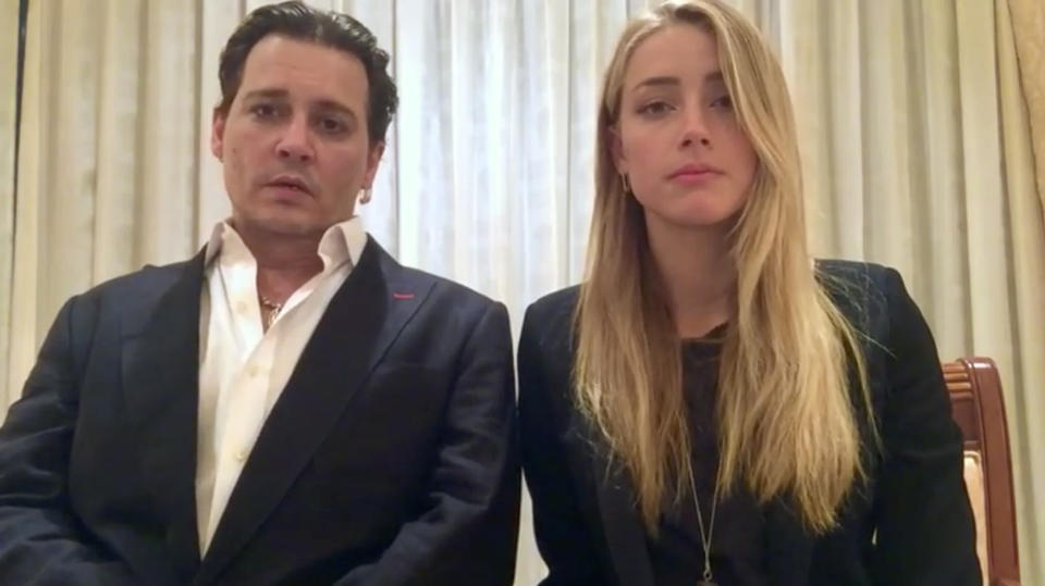 """In this image made from video released by the Australian Government Department of Agriculture and Water Resources on Monday, April 18, 2016, actor Johnny Depp and his wife, Amber Heard speak in a videotaped apology played during Monday's hearing at the Southport Magistrates Court on Queensland state's Gold Coast. Depp and Heard pleaded guilty Monday to providing a false immigration document amid allegations she smuggled the couple's dogs to Australia, but managed to avoid jail time over what was dubbed the """"war on terrier"""" debacle. (Australian Government via AP Video) AUSTRALIA OUT"""