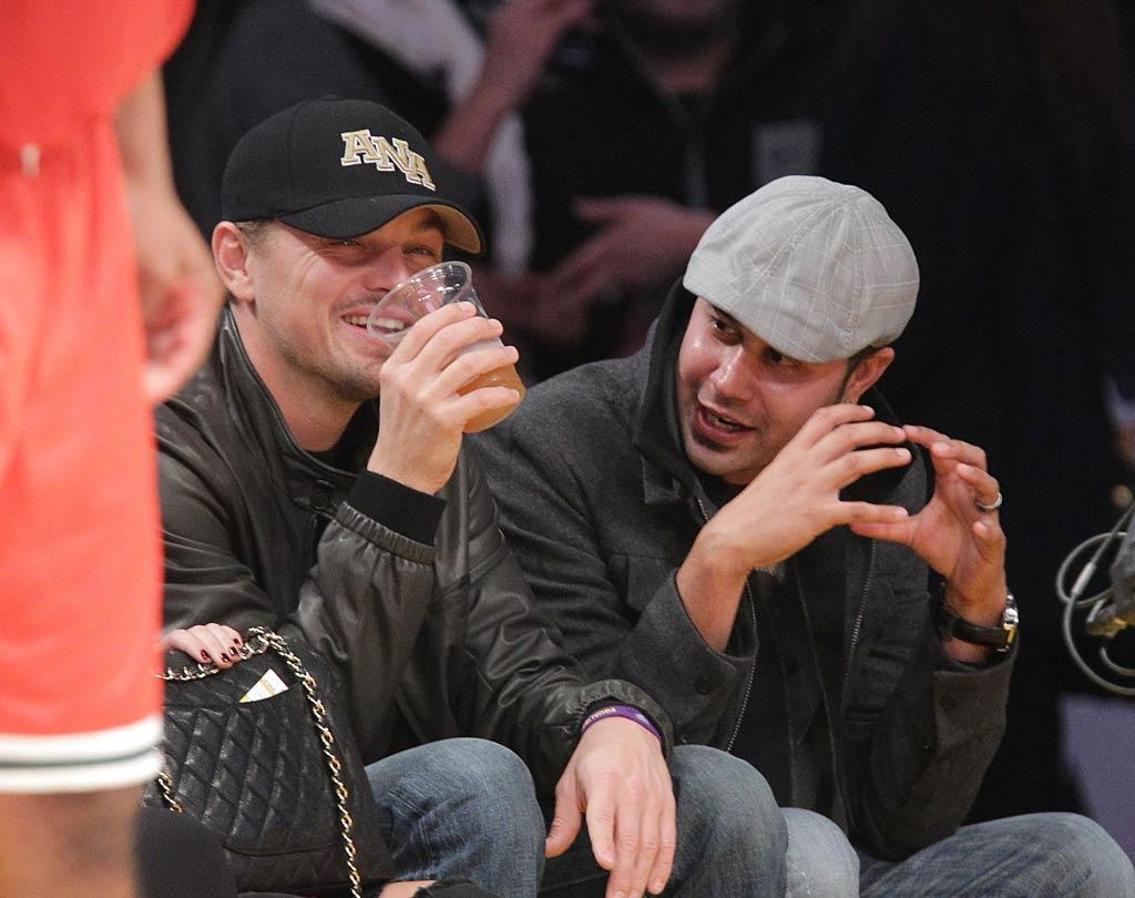 "Dedicated Lakers fan Leonardo DiCaprio kicked back in his usual courtside seat with a beer in hand to watch the game, where the home team was defeated by the Bucks 98-79. Noel Vasquez/<a href=""http://www.gettyimages.com/"" target=""new"">GettyImages.com</a> - December 21, 2010"