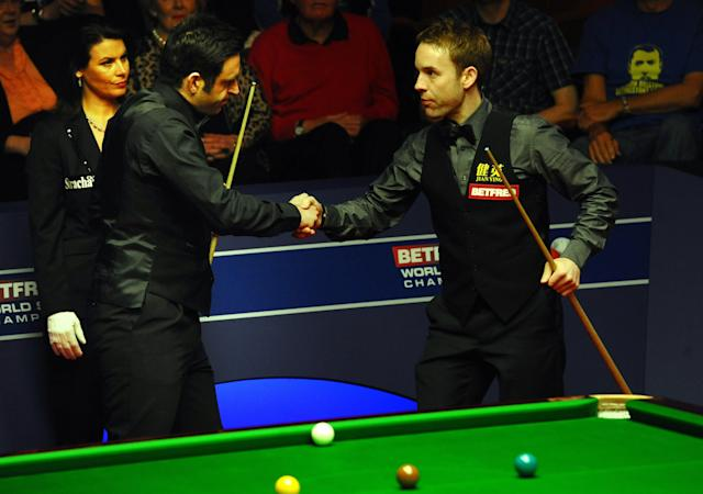Ronnie O'Sullivan of England shakes hands with Ali Carter of England ahead of the second session of the World Championship Snooker final at the Crucible Theatre in Sheffield, on May 7, 2012. AFP PHOTO/PAUL ELLISPAUL ELLIS/AFP/GettyImages